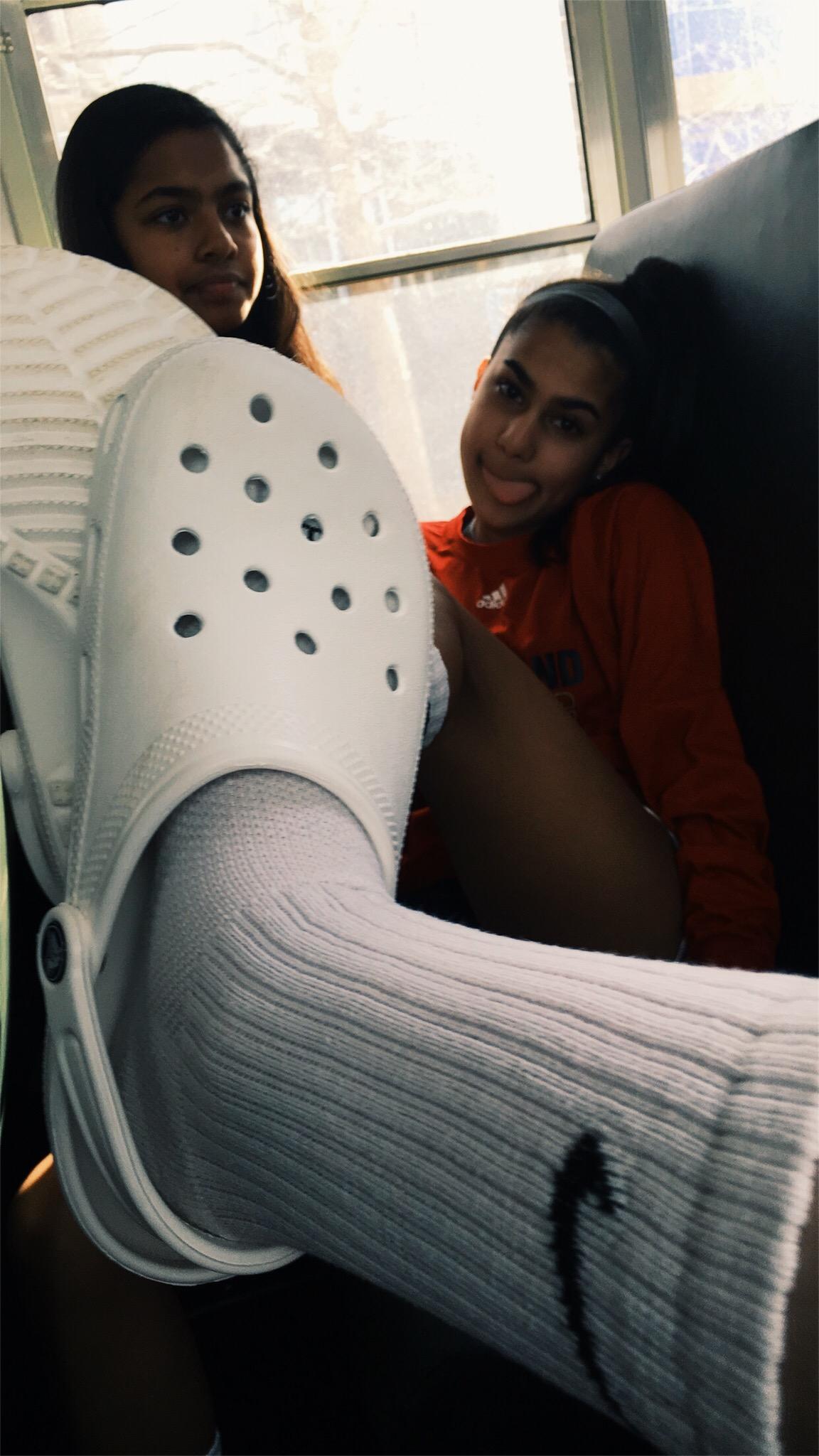 White crocs and Nike socks